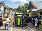 truk-menabrak-rumah-di-jalan-irian-i-kelurahan-kota.jpg