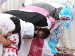 umat-muslim-melaksanakan-salat-ied_20180822_003431.jpg