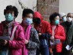 warga-hong-kong-mengenakan-masker-di-luar.jpg