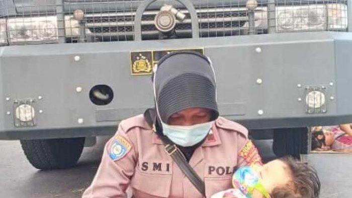 Cerita Polwan Amankan Sengketa Pilkada Sambil Gendong Anak, Fotonya Viral di Media Sosial