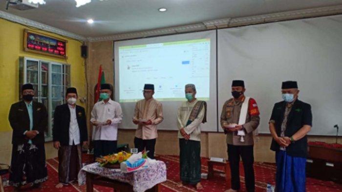 Pengurus Cabang Nahdlatul Ulama (PCNU) Kota Bogor menggelar Tasyakuran Hari Lahirnya Nahdlatul Ulama (Harlah NU) ke-95 di aula sekolah Al-Ghozali, Kota Bogor, Minggi (31/1/2021).