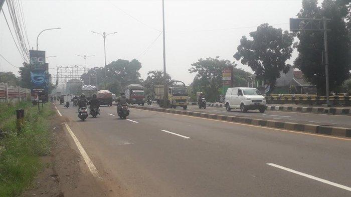 Lalu Lintas Kendaraan di Jalan Raya Jakarta-Bogor, Kawasan Sukaraja Saat Ini Ramai Lancar
