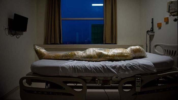 Pengalaman Fotografer Potret Jenazah Covid-19, Dibalut Plastik dan Lakban : Paling Memilukan