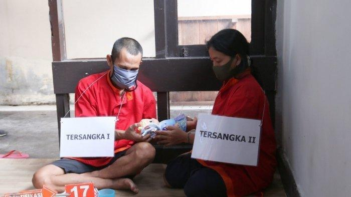 Kepolisian Sektor Telukbetung Selatan bersama Inafis Polresta Bandar Lampung menggelar rekonstruksi kasus pembunuhan bayi yang dilakukan ibu kandung dan selingkuhannya, Kamis (25/2/2021).