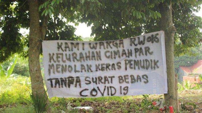 Pasang Spanduk, Warga di Cimahpar Kota Bogor Imbau Pendatang Bawa Surat Bebas Covid-19