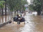 akses-jalan-panjang-di-depan-green-garden-masih-terputus-akibat-banjir.jpg