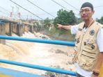 andi-sudirman-53-penjaga-bendung-katulampa-di-kelurahan-katulampa-bogor-timur-kota-bogor.jpg
