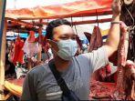andri-pedagang-daging-sapi-di-pasar-bojonggede.jpg
