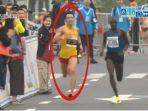 atlet-china-mencret-saat-ikut-lomba-lari-marathon.jpg