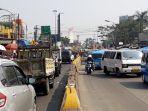 jalan-raya-puncak-depan-pasar-ciawi-kabupaten-bogor_20180730_102606.jpg