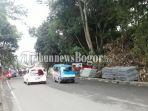 jalan-raya-puncak-tepatnya-di-kampung-ciasin-desa-bendungan-kecamatan-ciawi-kabupaten-bogor_20180307_195341.jpg