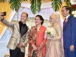 presiden-joko-widodo-dan-ibu-negara-iriana-jokowi-menghadiri-resepsi-pernikahan-pipiet-hanifan.jpg