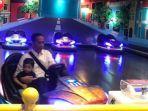 presiden-jokowi-bermain-bom-bom-car-dengan-cucunya_20180603_214925.jpg
