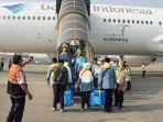 sejumlah-393-jemaah-haji-kloter-pertama-diberangkatkan-di-terminal-2-bandara-soekarno-hatta_20180717_134420.jpg