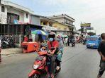 situasi-arus-lalu-lintas-di-depan-stasiun-bojonggede-kabupaten-bogor-selasa-3182021.jpg