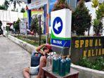 viral-pedagang-bensin-eceran-berjualan-di-depan-spbu.jpg