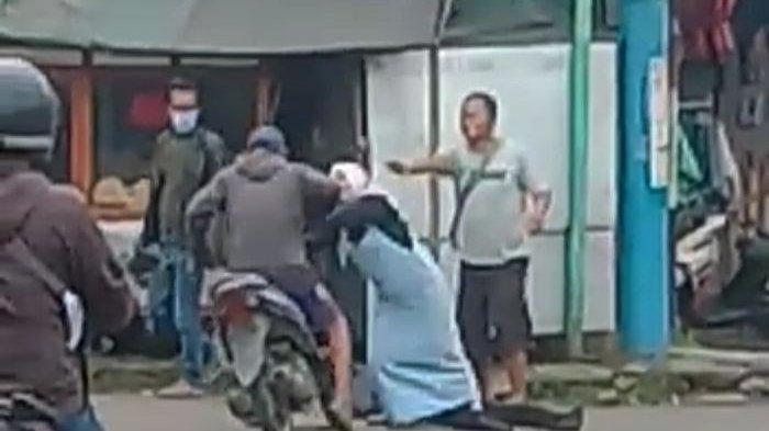 Aksi Heroik Ibu Berjilbab Adang Pemotor yang Akan Melindas Petugas ATM di Garut, Kini Dicari Polisi
