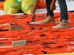 310-kantong-jenazah-berisi-bagian-tubuh-korban-jatuhnya-sriwijaya-air-berhasil-diangkut.jpg