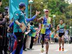agus-prayogo-raih-medali-emas-maraton.jpg