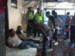 pelaku-pencurian-mobil-boks-saat-diamankan-di-pos-polisi-padalarangg.jpg