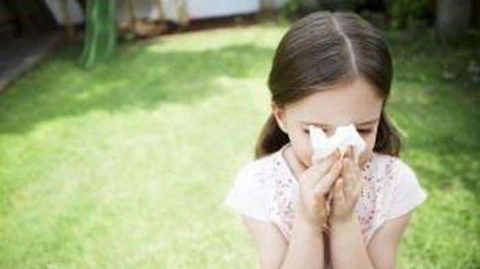 ilustrasi anak bersin karena alergi