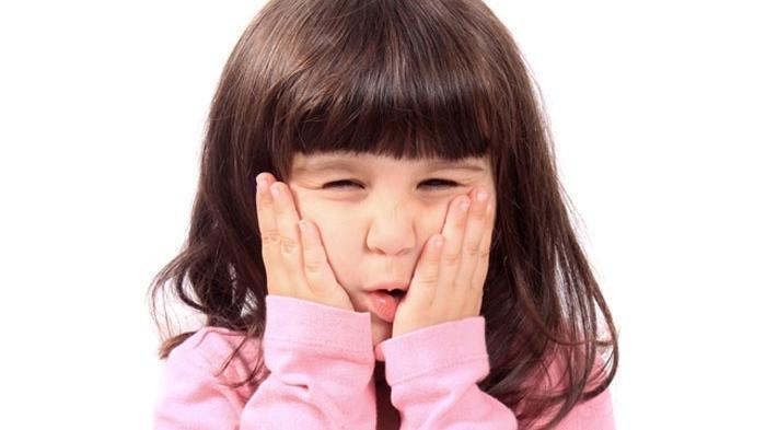 Ilustrasi sakit gigi pada anak-anak