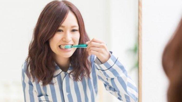 Ilustrasi - Menyikat gigi