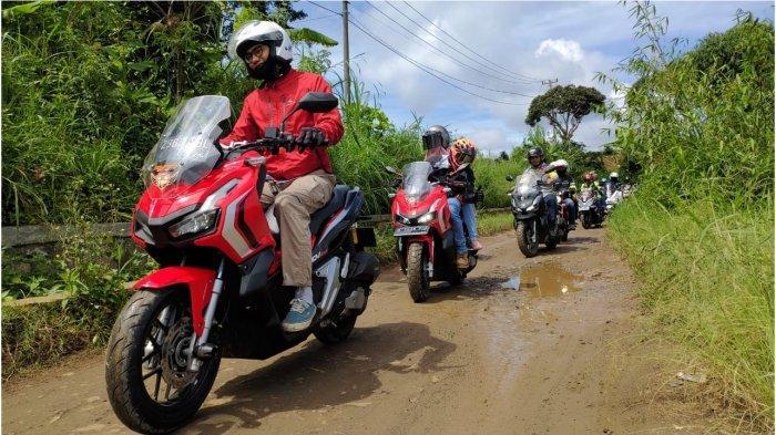Tips Aman Berkendara Melewati Jalan Rusak dan Berlubang