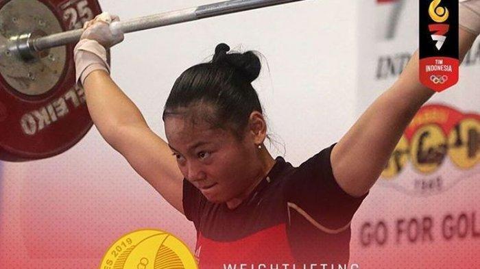 Lifter putri Indonesia, Windy Cantika Aisyah saat tampil dan merebut di kelas 48 kg di SEA Games 2019.
