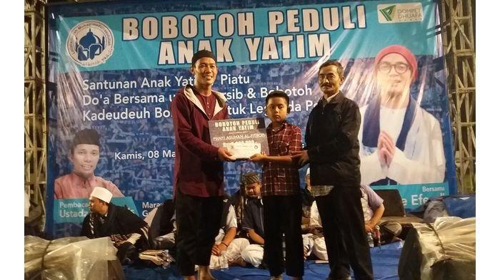 Henhen Puji Bobotoh yang Berhasil Menggelar Acara Amal untuk Anak Yatim dan Tausiah