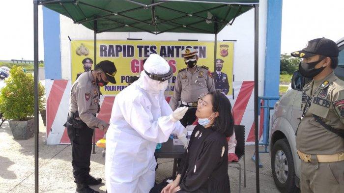 Polresta Cirebon Lakukan Rapid Test Antigen ke Pengendara di Rest Area KM 228 Tol Kanci - Pejagan