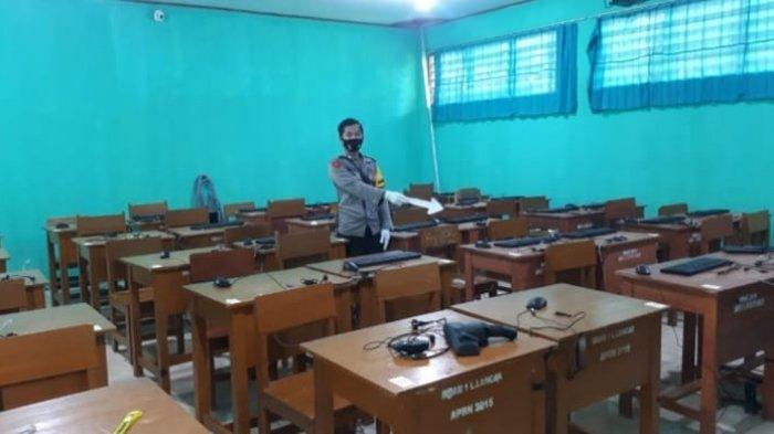 Pihak Kepolisian Melakukan Penyelidikan di TKP SMAN 1 Langkaplancar, Kabupaten Pangandaran.