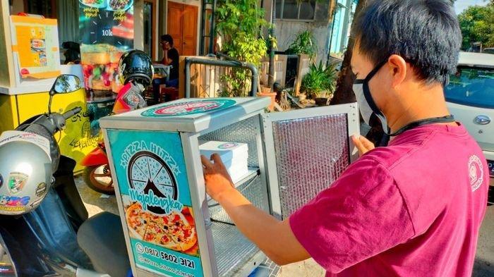Salurkan Hobi Fotografi, Penjual Pizza Hits Ini Gratiskan Ongkos Kirim, Ternyata Begini Hubungannya