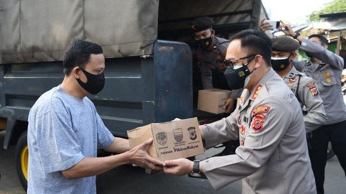 PPKM Darurat Diperpanjang, Ribuan Paket Sembako Dibagikan Polrestabes Bersama Paguyuban Tionghoa