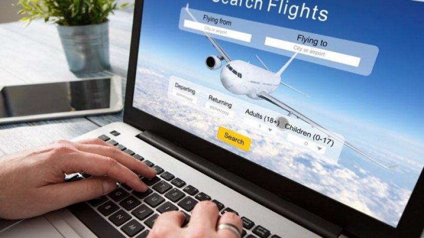illustrasi-pesan-tiket-pesawat-secara-online.jpg