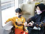 anak-12-tahun-bisa-naik-kereta-api.jpg