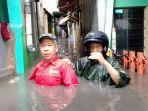 banjir-kembali-melanda-rw-07-kelurahan-cibadak-kecamatan-astanaanyar_20180521_172857.jpg