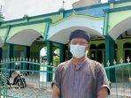 didin-nurudin-saat-berdiri-di-depan-masjid-jami-nurulmuhtadien-jatisawit.jpg