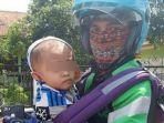 driver-ojol-di-bandung-viral-karena-gendong-bayi.jpg