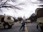 kendaraan-militer-garda-nasional-ditempatkan-di-dekat-gedung-capitol-hill.jpg