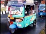 kendaraan-roda-tiga-bajaj-saat-digunakan-warga-urban-untuk-mudik.jpg