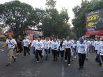 menteri-bumn-rini-soemarno-fun-walk-bersama-gubernur-jabar-ridwan-kamil.jpg