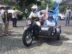 paslon-adjo-iman-mendaftar-ke-kpu-kabupaten-sukabumi-gunakan-sepeda-motor.jpg
