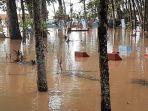 pemakaman-terendam-banjir-tasik.jpg