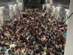 pesawat-penuh-sesak-pengungsi.jpg