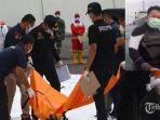 petugas-mengidentifikasi-kantong-jenazah-korban-jatuhnya-pesawat-sriwijaya-air-sj182_.jpg