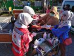 pmi-bantu-korban-gempa-lombok_20180810_201531.jpg
