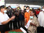 pos-indonesia-salurkan-bantuan-program-sembako.jpg
