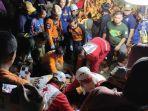 proses-evakuasi-mahasiswa-unsika-yang-terjebak-di-goa-lele.jpg
