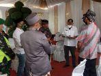 satgas-penanganan-covid-19-kecamatan-pamarican-membubarkan-resepsi-pernikahan.jpg